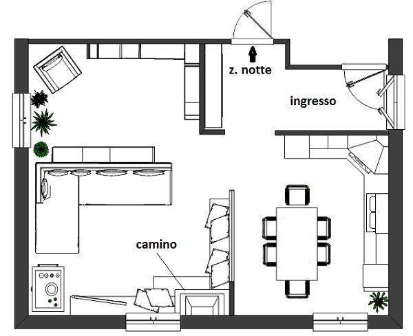 Camino tra soggiorno e cucina for Progettare un salone