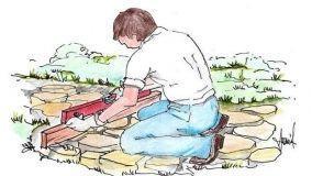 Vialetto in giardino con pietre irregolari: come realizzarlo