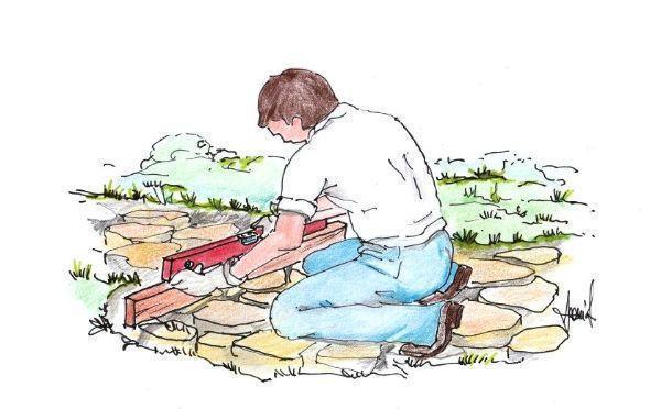 Livellamento pietre irregolari per vialetto in giardino