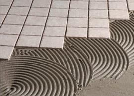 Adesivi cementizi impermeabili particolare di posa in opera di Torggler Chimica