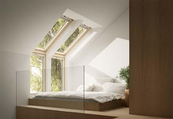 Finestra per tetti e un elemento verticale VELUX