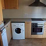La presenza di lavatrice nell'ambiente cucina