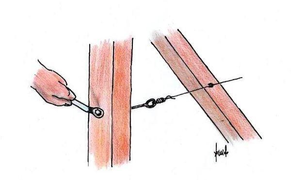 Messa in tensione di cavi per sostenere la rete metallica