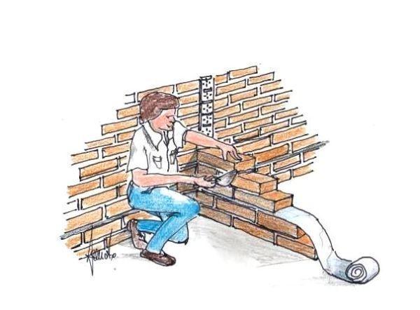 Posa a incastro delle teste dei mattoni entro il canale di acciaio