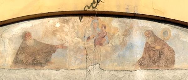 Due frati cappuccini venerano la Madonna di San Luca. Bologna, piazza Malpighi.