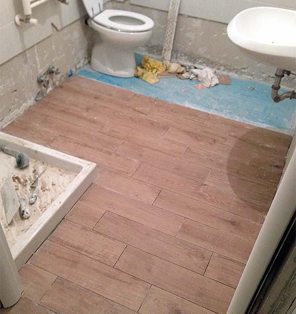 ristrutturazione bagno fai da te installazione pavimento by fabio mainero