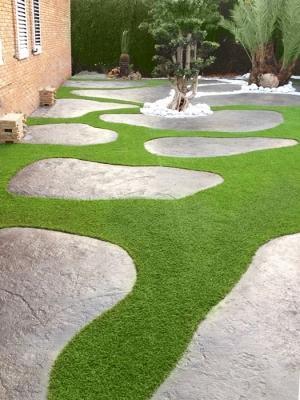Pavimento in calcestruzzo stampato a imitazione di rocce naturali; by Isoplam.