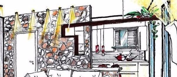 Parete in pietra per dividere living e cucina