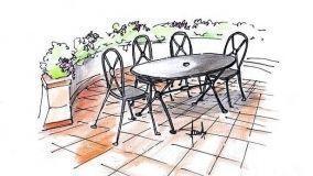 Una terrazza circolare con arredi in ferro battuto