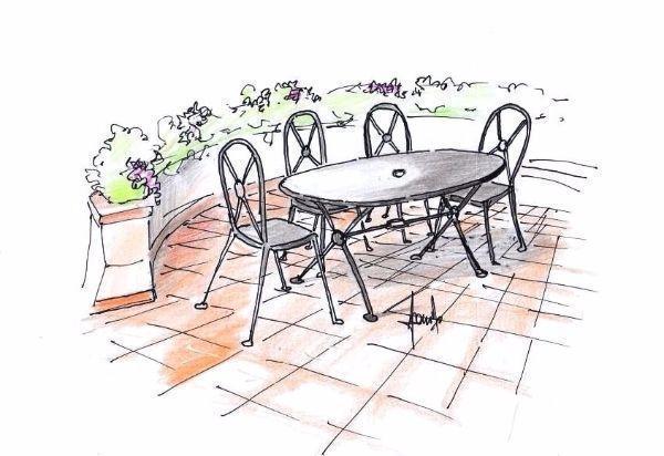Angolo colazione in terrazza con arredi in ferro battuto
