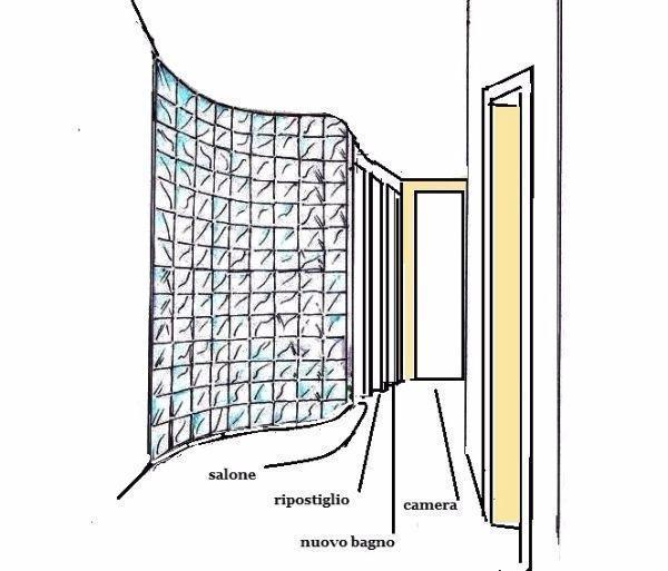 Una strategica parete in vetrocemento divide gli spazi nell'appartamento di 100 mq