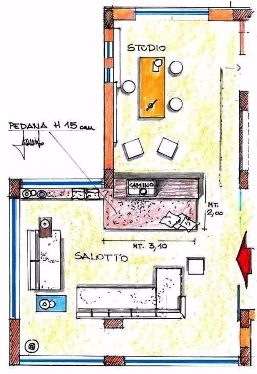 Camino bifacciale come interparete fra salotto e studio