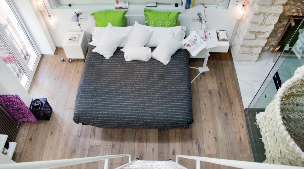 Camera da letto di un open space - arredamento Lago