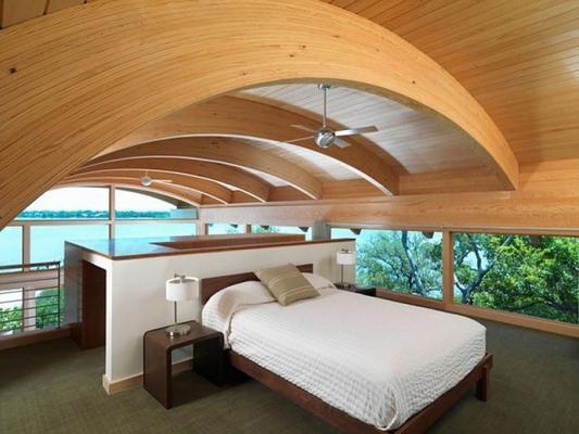 Camera da letto con curve in legno lamellare, di Prolegno