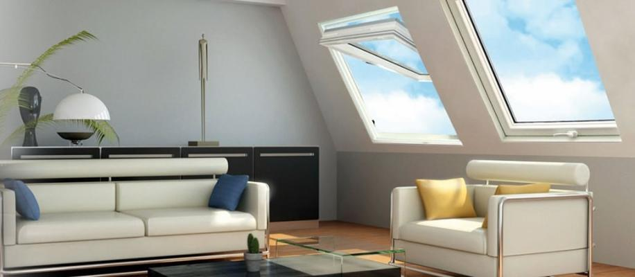 Zona living sottotetto con finestre Claus