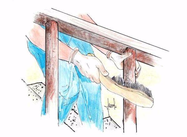 Eliminare la ruggine dalla ringhiera in ferro di una scala