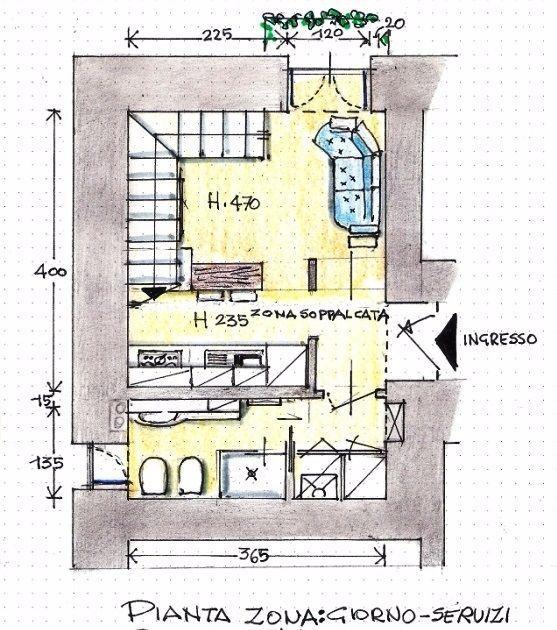 Zona giorno con angolo cottura e servizi: pianta di progetto