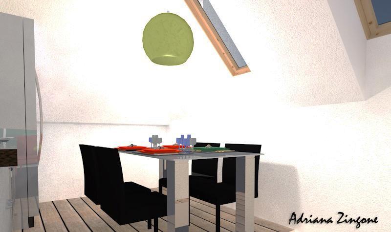 Cucina in mansarda illuminata da finestre Velux