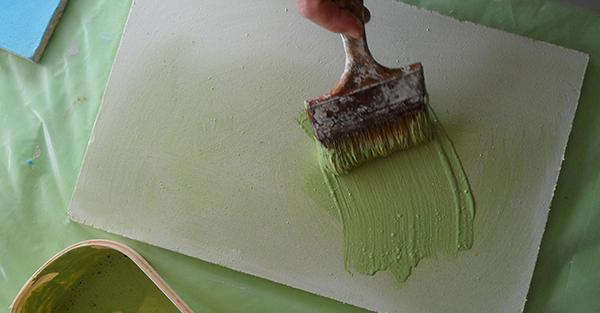 Prove di tinteggiatura a calce su una tavella intonaca, La Banca della Calce