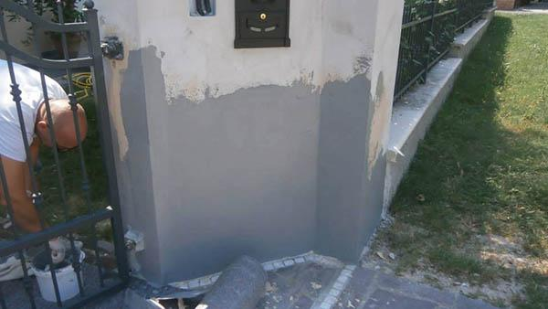 Applicazione della Suberite sul muro di cinta di una casa, EasyBiz Servizi