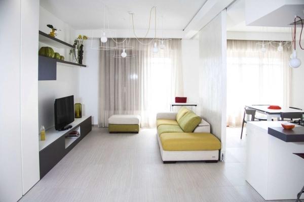 Zona salotto in open space Il Legno Arredamenti