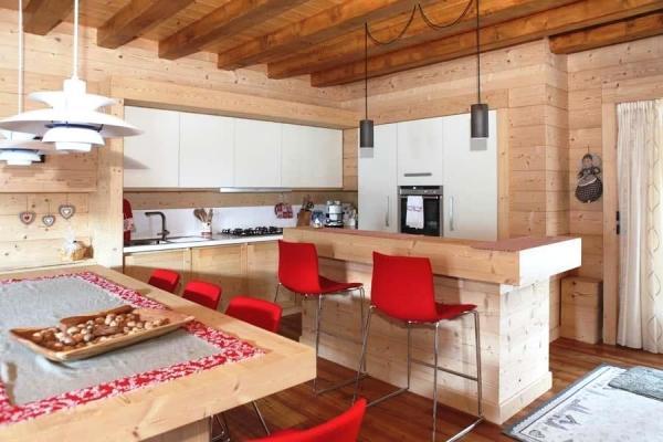 Zona cucina open space in legno, di DGM Arredi