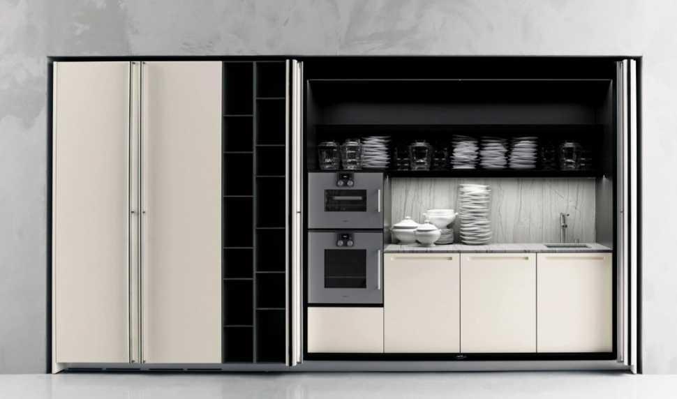 Arredamento soggiorno open space con cucina a scomparsa Boffi Hide