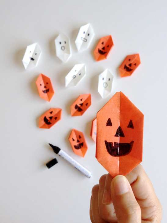Zucche di Halloween origami faccine, da handmadecharlotte.com