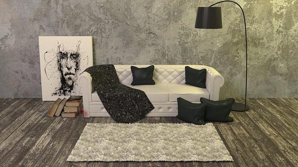 Cuscini e plaid per un divano caldo e accogliente