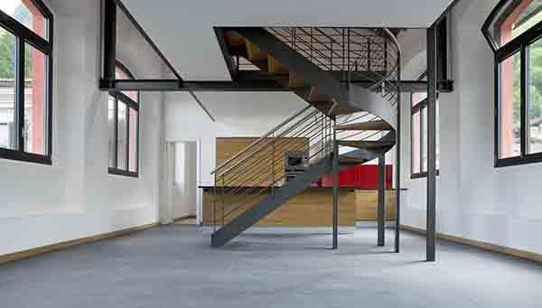 Alloggio duplex tipo loft con scala in stile industriale