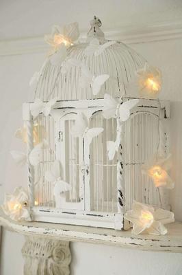 Riciclo gabbiette per uccellini per arredare casa, da southernhospitalityblog.com