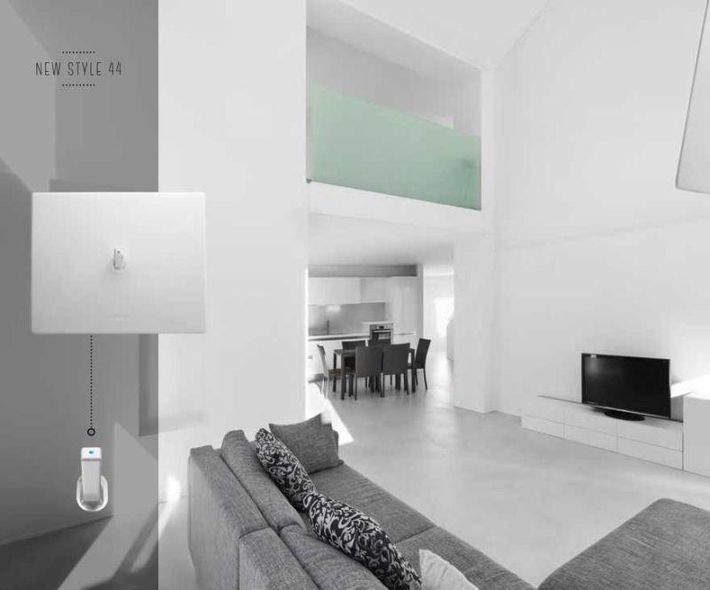 Interruttore e levetta minimal AVE New Style 44 con placca bianca in Corian