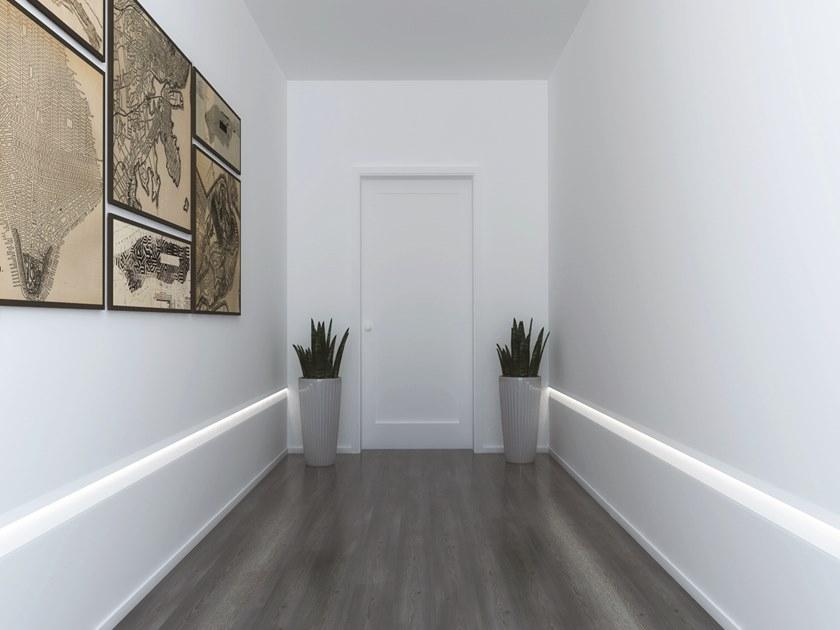 Una corretta illuminazione artificiale può far percepire il corridoio meno lungo