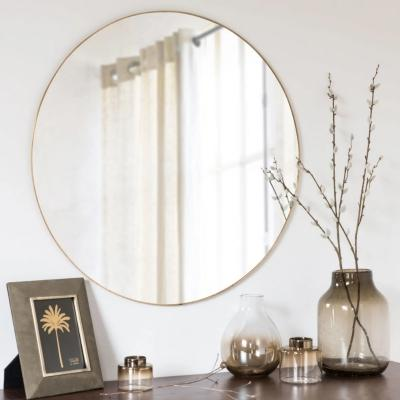 Specchio in metallo dorato by Maison du Monde
