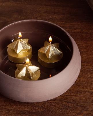 Collezione natalizia Zara Home: candele a forma di stella