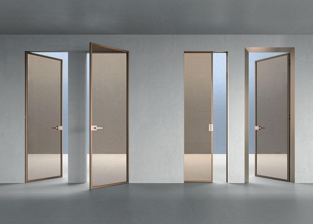 Modelli di porte rasomuro in vetro con telaio in bronzo-chiaro - ECLISSE