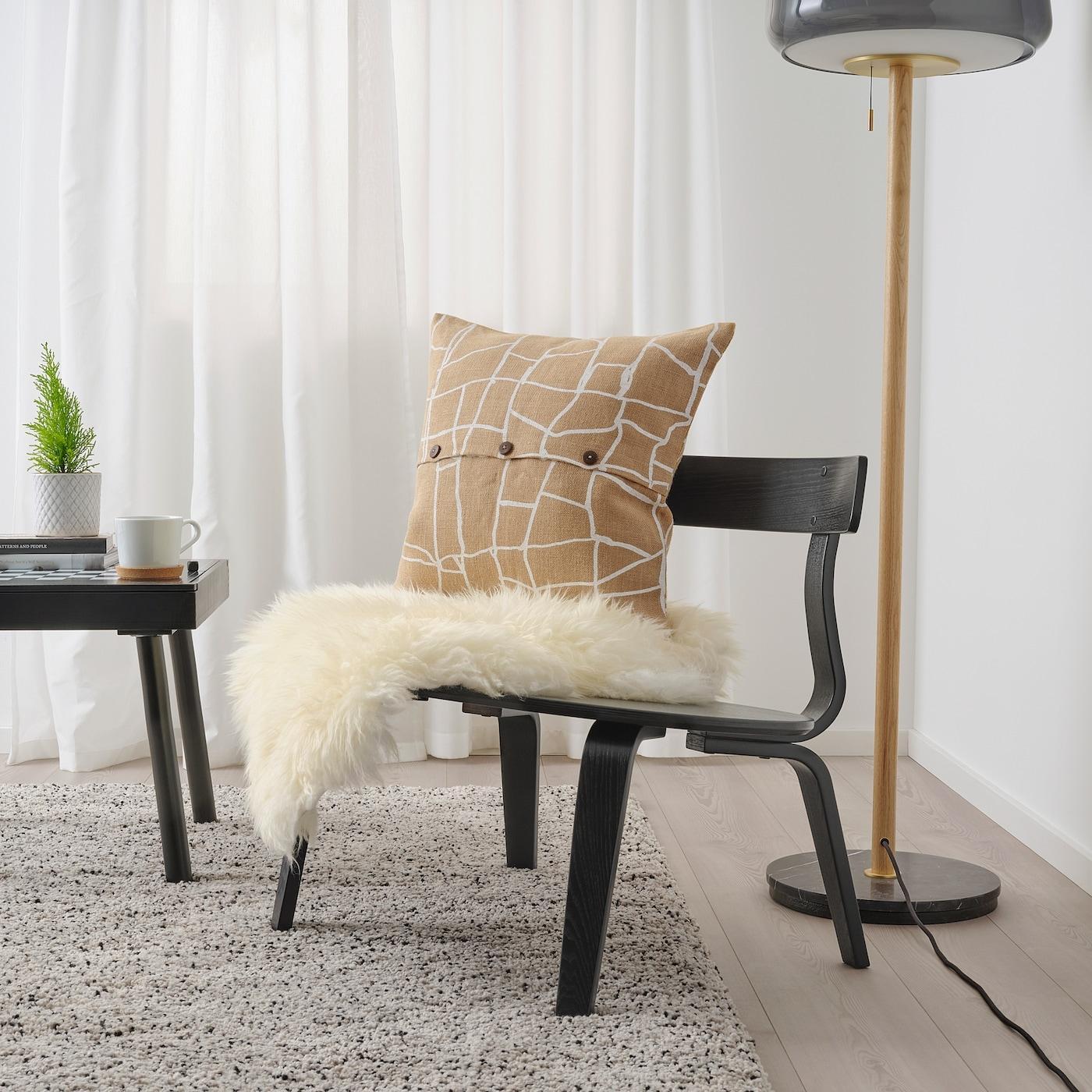 Poltrona e federa per cuscino VÄRMER - Design e foto by Ikea