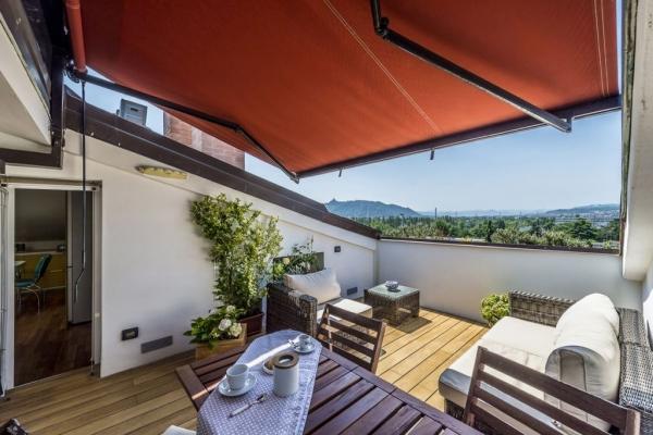 Terrazzo attico con tenda - BBP Ingegneria