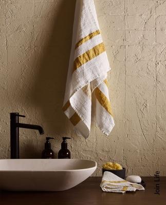 Asciugamani in lino waffle a righe, da Zara Home