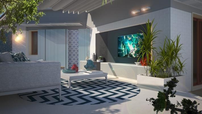 Area living con parete tv sul terrazzo progetto Blu Space