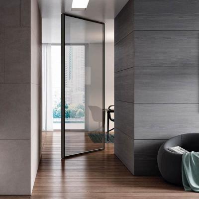 Porta Vela Unik. profili antracite e vetro trasparente fumé - Foto by Bertolotto