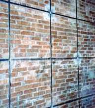 La cucitura delle murature: una cucitura su pannello in mattoni pieni