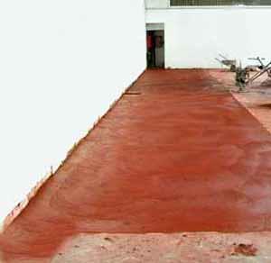 I danni provocati dal gelo alle pavimentazioni in calcestruzzo: l'applicazione dello strato di finitura