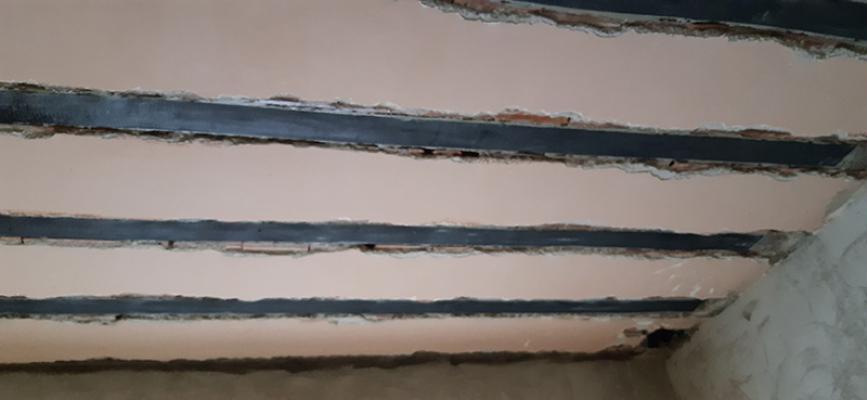 Consolidamento solaio all'intradosso con più strati di tessuto sovrapposti