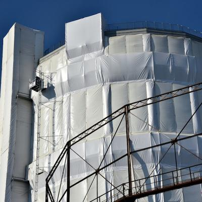 Materiali edili da rifiuti plastici: teli di protezione facciate