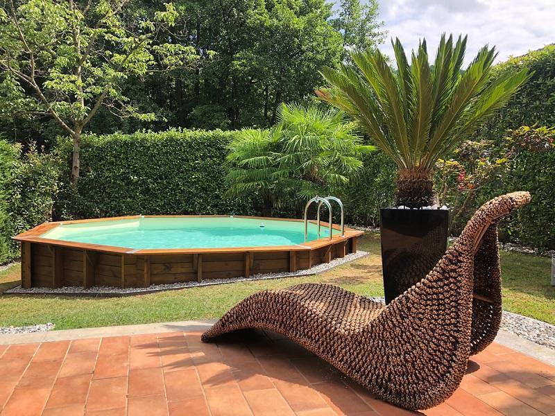 Piscina seminterrata in legno di Piscine Italia