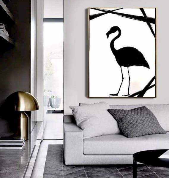 Quadro sul divano in bianco e nero con particolare oro - Credits Pinterest
