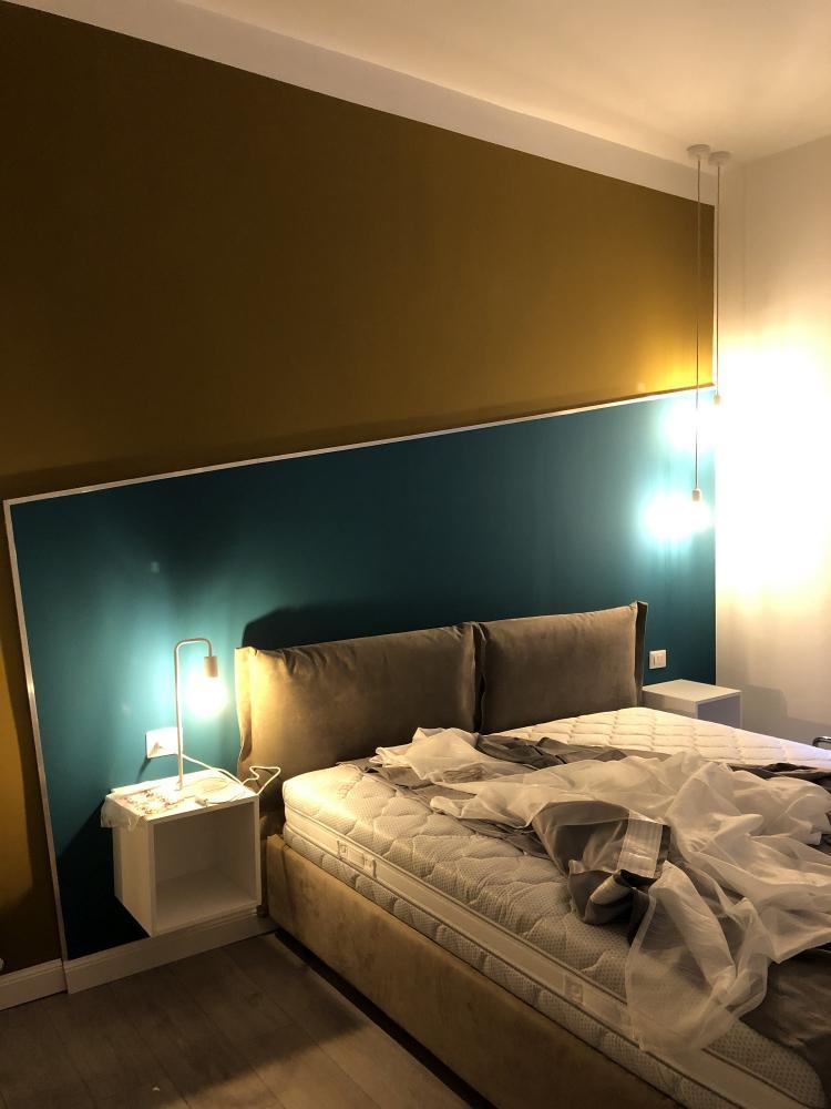 Ambiente camera da letto in un bilocale di 45 mq