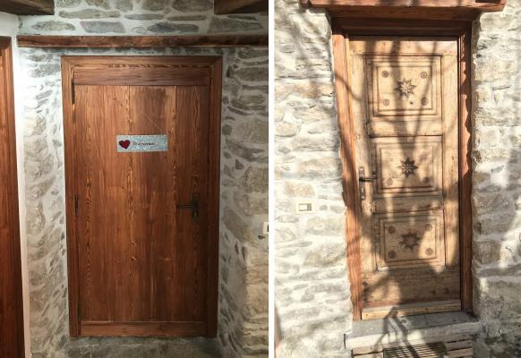 Materiali casa montagna - muratura in pietra e porte in legno