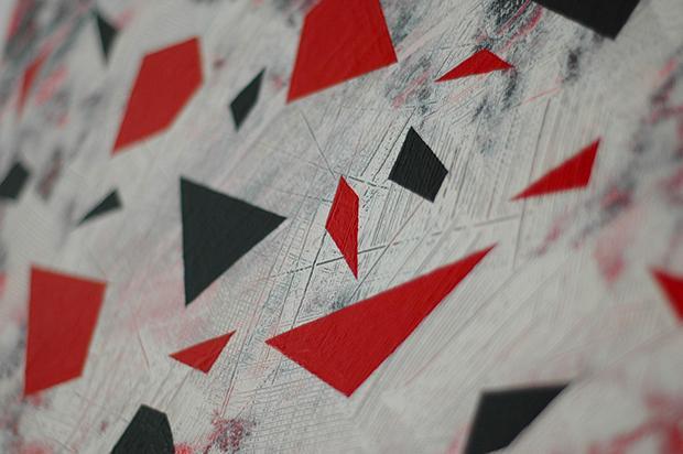 Two-tone triangular geometries on the wall